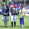 Jonelle Price receives the Mitsubishi Motors Trophy from The Princess Royal.  Also pictured on right is Lance Bradley, Vice-Chairman of Mitsubishi Motors UK and owner of Classic Moet, Trisha Rickards