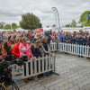 Crowds gather to watch the press conference with the overnight top three riders at the ChatZone