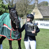 Jonelle Price looking lovingly at her Badminton-winning horse, Classic Moet