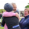 Imogen Murray being congratulated by her parents following a stunning clear round