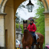 Louise Harwood and 'Whitson' looking cheery as they leave the stables
