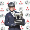 Michael Jung lifts the Mitsubishi Motors trophy