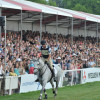 Mark Todd salutes a cheering crowd