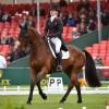 Kristina Cook (GBR) riding De Novo News