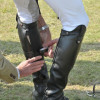 Mark Todd's gaiters are quickly repaired before the prize giving