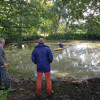 New Pond - Alan Willis and Giuseppe della Chiesa watch as the depth is tested