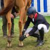 Oliver Townend adjusting Armada's boots