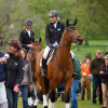 Alice Plunkett celebrates with Spencer Sturmey as riders go into the prize-giving