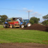 Sand and compost are mixed to top dress the arena and cross country