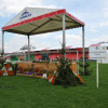 Watering flowers at the Mitsubishi Motors Finale, the final XC fence
