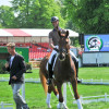 Ulrik Molgaard's young horse happily follows Carl Hester