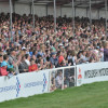 The crowd in the arena cheer the riders home