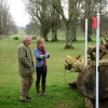 Lizzie Greenwood Hughes and Giuseppe discuss a fence