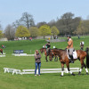 The 4* riders school their horses, while the Grassroots Championship XC takes place in the background