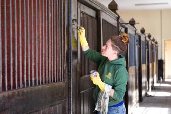 Alex ensuring the stables are pristine