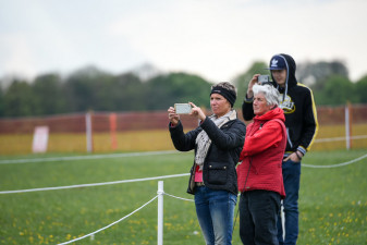 Supporters snapping away at the Mitsubishi Motors Cup