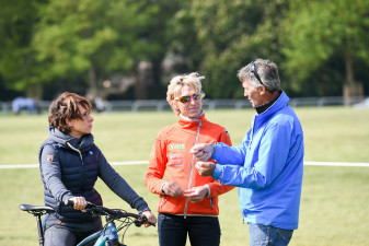 Andrew showing Bettina and Ingrid how he plans to tackle the course