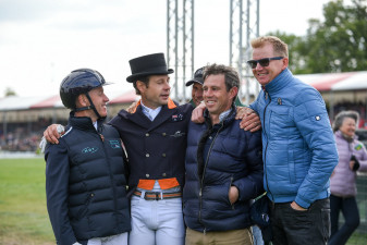 Group hug - Christopher Burton is congratulated