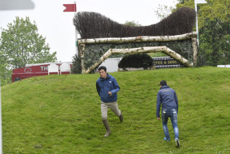 Toshiyuki Tanaka and Kazuma Tomoto from Japan walk the Nyetimber Heights fence