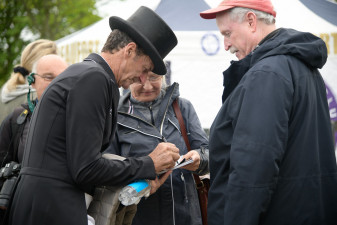Sir Mark Todd signing programmes for his fans