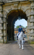 The stunning Collien P II walking through the iconic archway on their way to the dressage