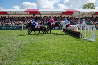 Packed grandstand watching the Pony Grand National