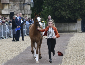 Oops! Dargun flies through the first horse inspection and Emily King's hat flies away