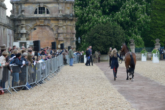 The crowds gather down in front of Badminton House to watch the first horse inspection