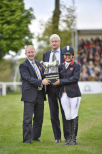 Piggy French receiving the Mitsubishi Motors Trophy from The Duke of Beaufort (centre) and  Robert Lindley Managing Director of Mitsubishi Motors UK