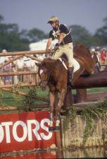 Mark Todd on Bertie Blunt, negotiates the lake with a broken stirrup, Badminton Horse Trials 1995