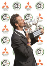 Mark Todd kissing his 2011 Mitsubishi Motors Badminton Horse Trials Trophy