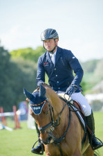Michael Jung goes into the show jumping