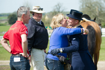 A hug from Mum for Michael Jung after he goes into the lead