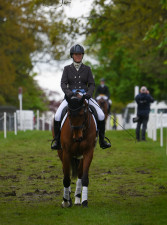 Imogen Murray and Ivar Gooden looking in the zone as they arrive at the dressage warm-up arena