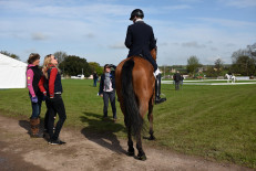 Sam Ecroyd, our guinea pig dressage rider, analysing his test with Mary and Emily King