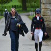 Izzy Taylor and Alex Van Tuyll making their way to the stables before Izzy's dressage test