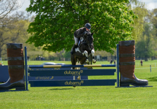 Flying over the iconic Dubarry Burghley Young Event Horse fence