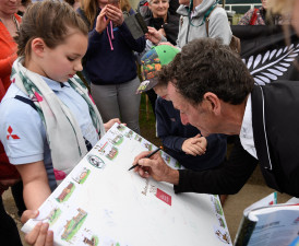 Mark Todd takes time to sign this brilliant board - This girl is doing a great job of getting all the signatures so far