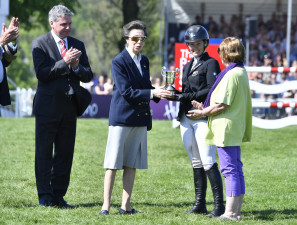 The Princess Royal presents the William Miflin trophy for the cross country time nearest the Optimum time to Jonell Price (NZL) L to R: Lance Bradley Vice-president of Mitsubishi Motors UK, The Princess Royal, Jonelle Price and owner Trisha Rickards
