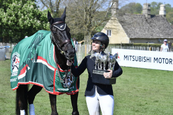 Jonelle Price looking lovingly at her Badminton-winning horse, Classic Moet