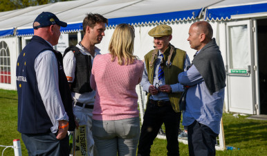 Harry Meade chatting with rugby coach, Eddie Jones and veterinarian, Graham Potts after his inspiring round on Away Cruising