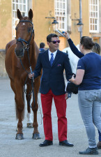 The horse looks immaculate, but the groom clearly felt Cedric Lyard needed a last-minute brush