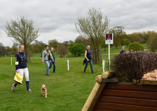 Lissa lining it up - Lissa Green walks the course, with her from her dog, Rico